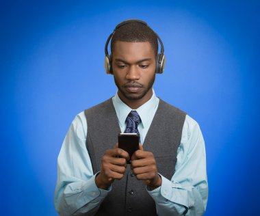 man with headphones using smartphone