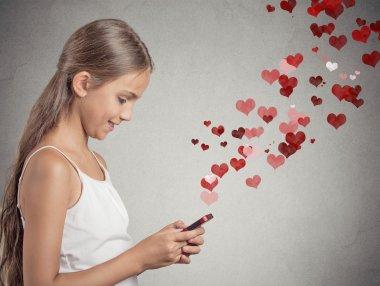 teenager girl using texting on smart phone