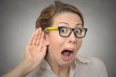 nosy woman hand to ear gesture