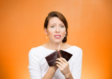 unhappy business woman showing empty wallet