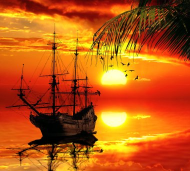 old sailboat on a sunset skyline