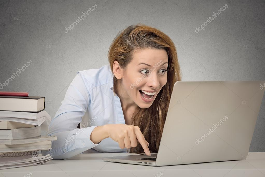 Funny woman working on computer ready to press enter button