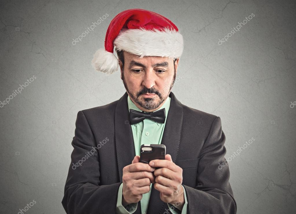 man in santa claus hat looking at smartphone searching online deal