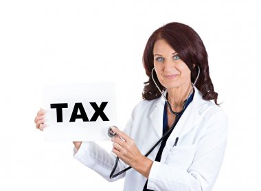 female doctor listening with stethoscope tax sign