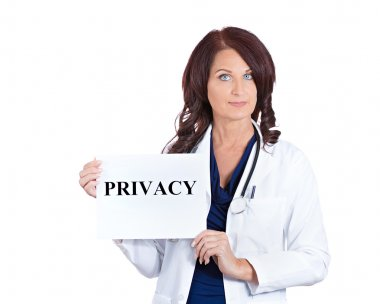doctor holding privacy sign