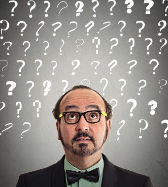 man puzzled question marks above head