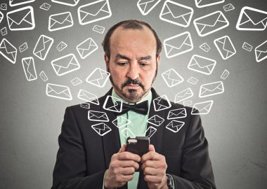 man sending message email from smartphone