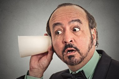 curious businessman listening to conversation