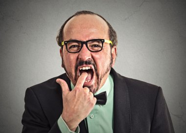 disgusted man with finger in mouth