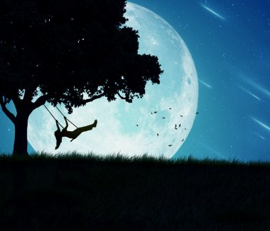 woman swinging of a tree isolated on background of moon, earth, night skyline