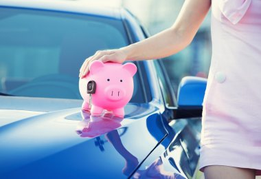 woman customer, agent and new car, pink piggy bank key on hood