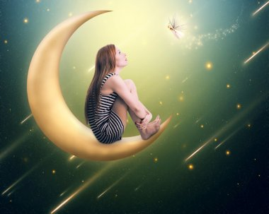 lonely thoughtful woman sitting on the crescent moon