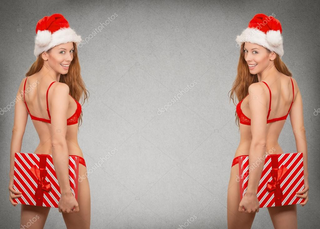 sexy christmas woman in santa hat wearing red lingerie
