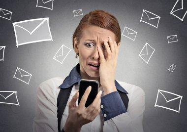 stressed woman shocked with message on smartphone