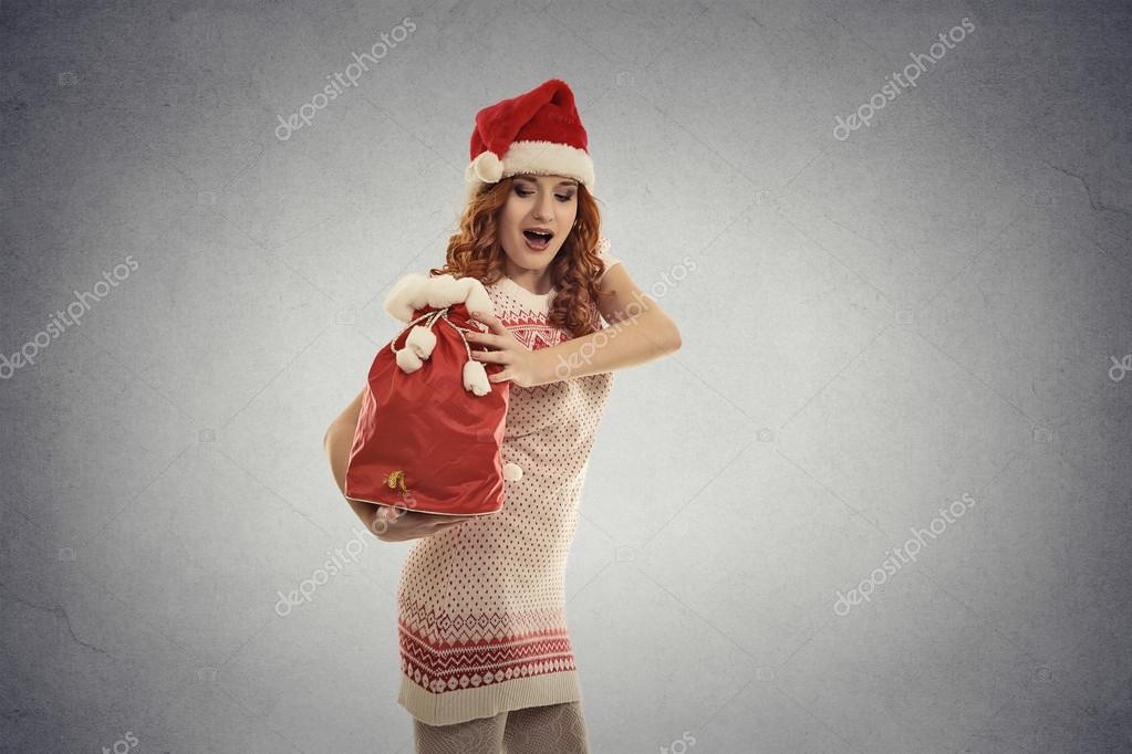 Santa Helfer Mädchen tragen große rote Weihnachten Sack voller ...