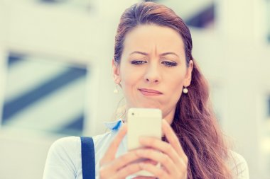 upset sad skeptical unhappy serious woman talking texting on mobile phone