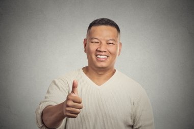 smiling man employee giving thumbs up sign gesture