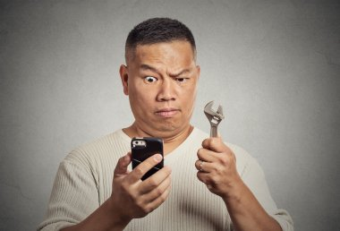 Business idea solution tools concept. Man with smartphone
