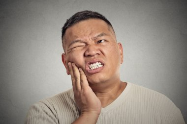 man touching face having bad pain, tooth ache