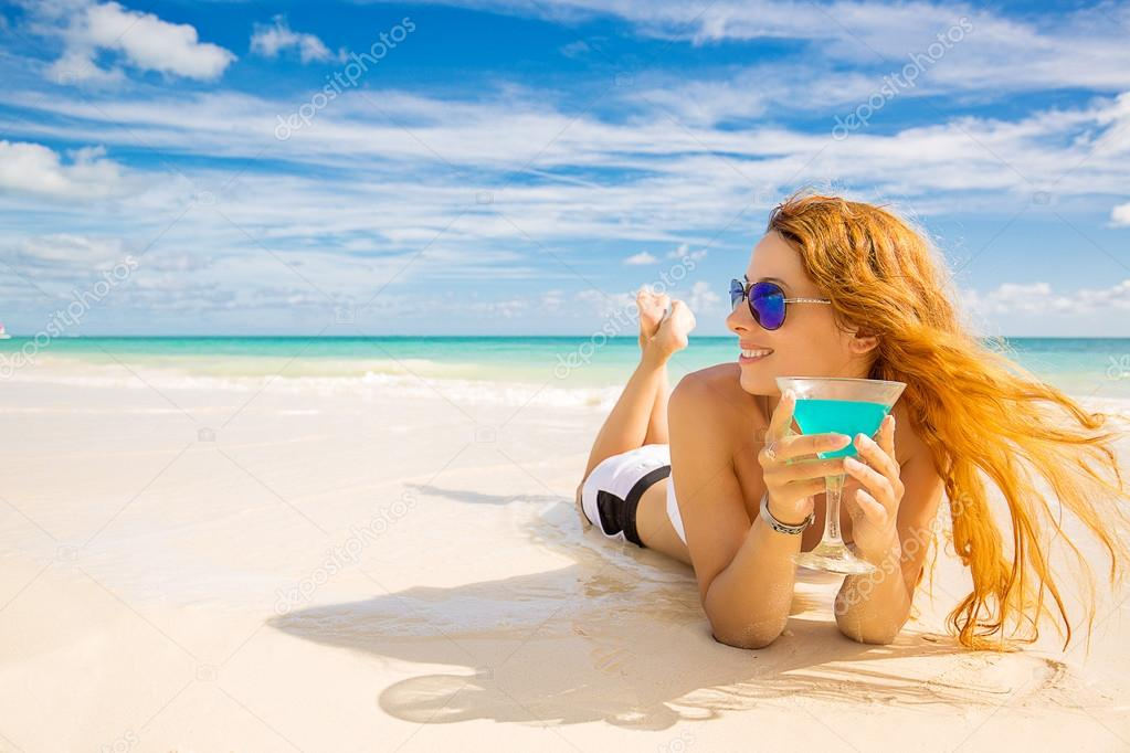 happy woman on the beach enjoying sunny weather