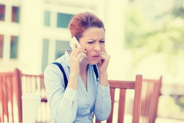 upset sad skeptical unhappy serious woman talking on phone