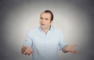 clueless funny looking young man, arms out asking what's the problem