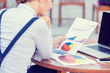 investment consultant analyzing company annual financial report