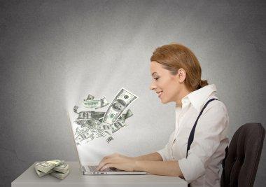 Woman using her laptop computer making money