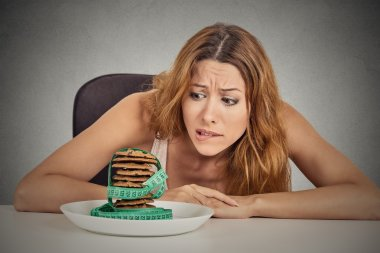 woman craving sugar sweet cookies but worried about weight gain