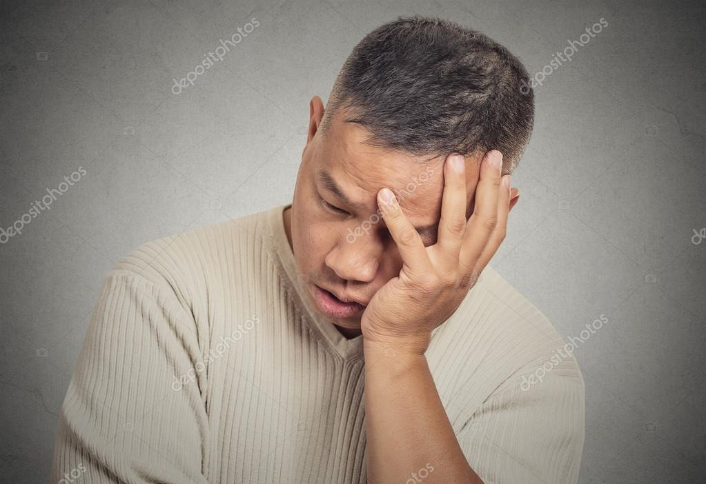 Portrait headshot sad bothered stressed middle aged man
