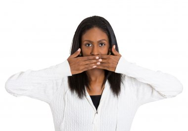 middle aged woman covering closed mouth