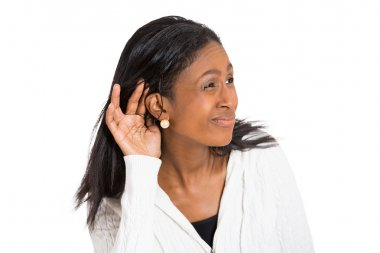unhappy hard of hearing woman placing hand on ear