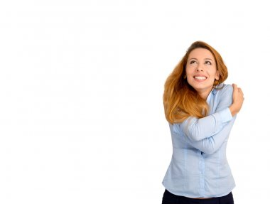 woman holding hugging herself looking up at copy space