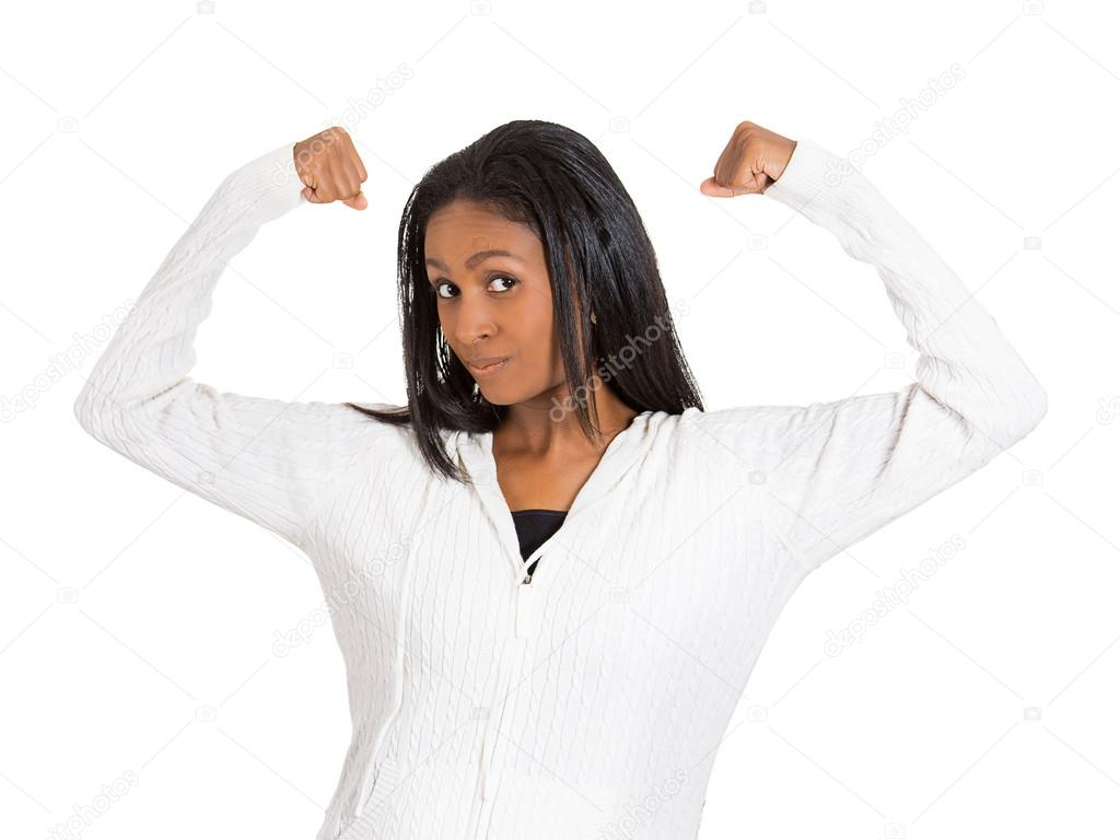 Middle aged healthy model woman flexing muscles