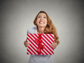 Gift box in hands of young happy woman