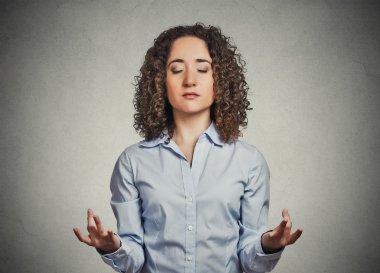 young woman meditating eyes closed