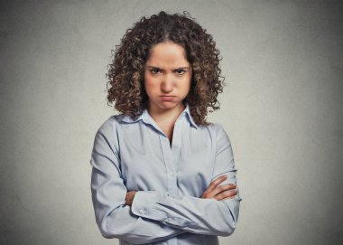 angry young woman puffing cheeks