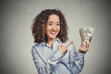 happy excited successful young business woman holding money dollar bills