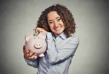 smiling business woman bank employee, student holding piggy bank