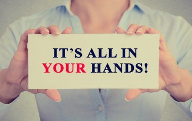 businesswoman hands holding card with It's All in Your hands! message