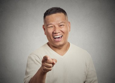 young man, laughing, pointing with finger at someone