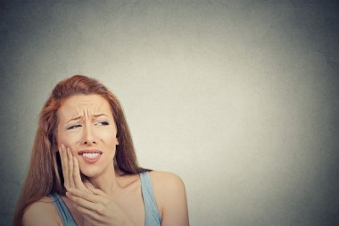 woman with sensitive tooth ache crown problem