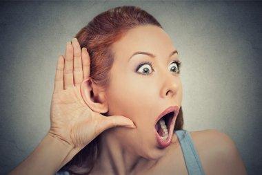 nosy shocked woman listening eavesdropping