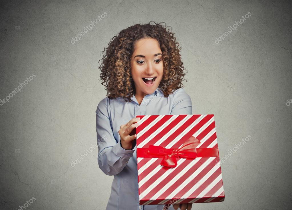 Happy woman opening unwrapping red birthday gift box