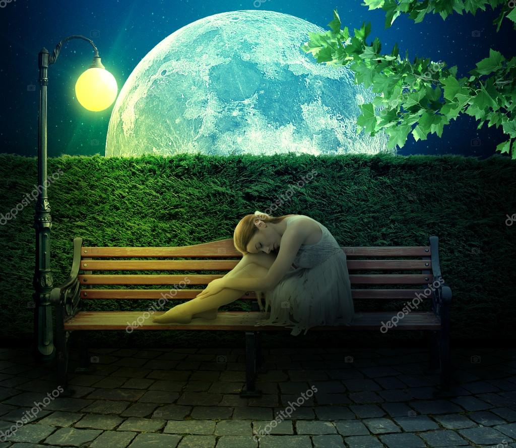 girl sitting on bench on big moon background