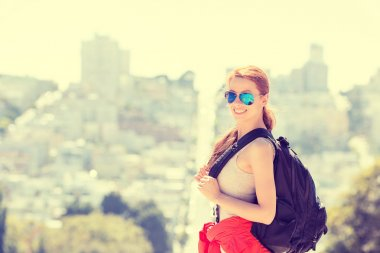 Woman with backpack sunglasses traveling in San Francisco city