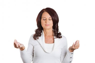 woman with eyes closed hands raised in air meditating