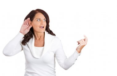 Curious woman hand to ear gesture eavesdropping
