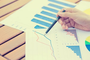 business woman hands pen presenting financial statement document