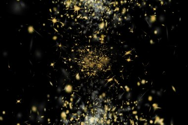 Freeze motion of shiny yellow golden particles exploding scatter